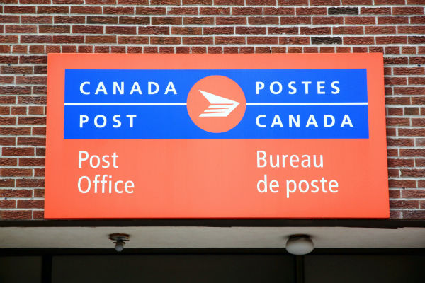 Sign indicating Canada Post within a Northern/NorthMart Store